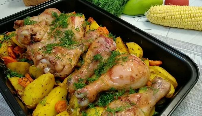 Готовая курица с картошкой в духовке